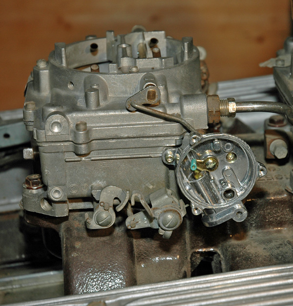edelbrock choke housing mounts to the carburetor in the same manner as the  old choke housing via three screws supplied in the kit